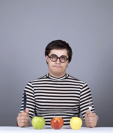 Free Funny Boy Try To Eat Apples. Royalty Free Stock Image - 16755806