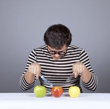 Free Funny Boy Try To Eat Apples. Royalty Free Stock Image - 16755816