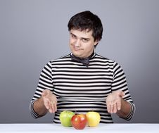 Free Funny Boy Try To Eat Apples. Stock Photography - 16755822
