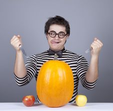 Free The Young Mad Men Try To Eat Apples And Pumpkin. Stock Photography - 16755862
