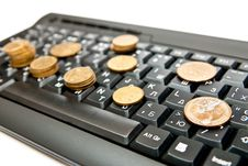 Free Coins On Keyboard Stock Photos - 16756253