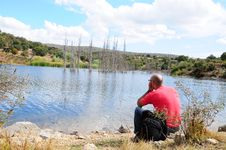 Free Man Sits By A Lake (sea) Stock Photo - 16757420