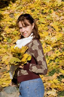 Free The Beautiful Girl With Autumn Leaves Royalty Free Stock Images - 16757739