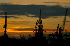 Silhouettes Of Cranes In The Port Stock Images