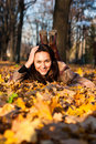 Free Beautiful Young Woman Lying In Autumn Leaves Royalty Free Stock Photos - 16766018