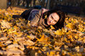 Free Beautiful Young Woman Lying In Autumn Leaves Stock Photography - 16766192