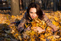 Free Beautiful Young Woman Lying In Autumn Leaves Royalty Free Stock Photos - 16766308