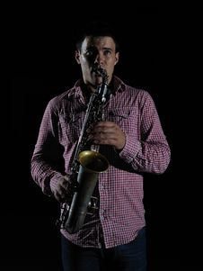 Free Young Handsome Man Playing Music On Saxophone Royalty Free Stock Image - 16760226