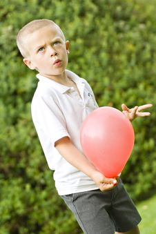 Free Six Year Old Boy Holding A Balloon Royalty Free Stock Image - 16762706