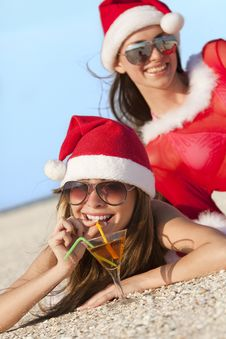 Free Women In Christmas Suit With Martini On The Beach Royalty Free Stock Image - 16763266