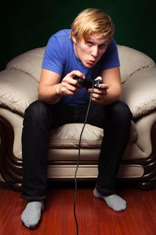 Free Young Man Playing Video Games Stock Photos - 16763423