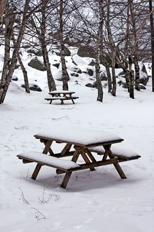 Snow On Wooden Benches At The Park Stock Photography
