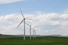 Free Wind Turbines In Green Fields Royalty Free Stock Image - 16764816