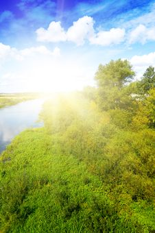 Blue River, Cloud Sky, Green Shores Stock Photos