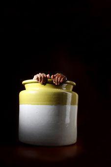 Man Hiding In A Pot Stock Photo