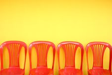 Free Red Chairs On Yellow Stock Photo - 16765260