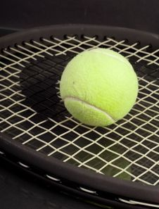 Free Tennis Ball On Racket Stock Photography - 16765702