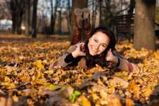 Beautiful Young Woman Lying In Autumn Leaves Royalty Free Stock Images