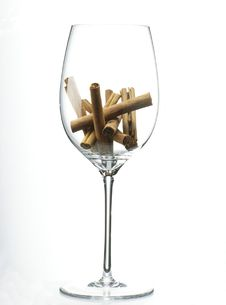 Sticks Of Cinnamon In A Glass Of Wine Royalty Free Stock Photography