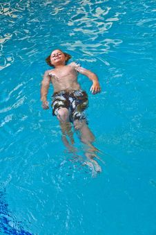 Boy Enjoys Swimming Royalty Free Stock Images
