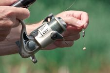 Fisherman Hand Holding A Fishing Rod Royalty Free Stock Images
