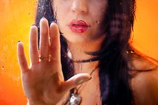 Woman Behind Glass Stock Photography