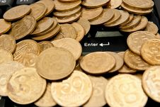 Free Coins On Keyboard Stock Photography - 16776122