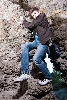 Free Trendy Man Climbing In The Cave Royalty Free Stock Images - 16776889