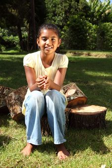 Free Young Happy School Girl Outdoors Sitting On Logs Royalty Free Stock Photos - 16777068