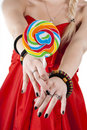Free Young Girl Is Holding A Lollypop Stock Photo - 16788170