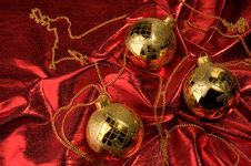 Free Gold Baubles With Red Backdrop Royalty Free Stock Image - 16781206
