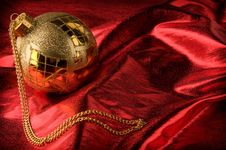 Free Gold Baubles With Red Backdrop Stock Photos - 16781593