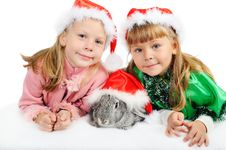 Free Two Girls With A Rabbit On White Stock Photo - 16782620
