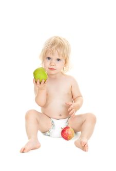 Free Sweet Baby Girl Holding A Green Apple Stock Photos - 16782883