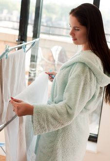Free Beautiful Woman Hanging Clothes Royalty Free Stock Photography - 16783267