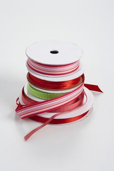 Free Five Spools Of Ribbon Stacked Stock Images - 16784834