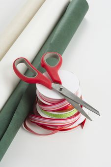 Scissors With Ribbon And Gift Wrapping Royalty Free Stock Photos