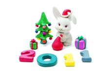 Free Text 2011, Rabbit, Gifts And Christmas Tree Royalty Free Stock Photo - 16785675