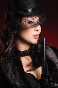 Elegant Lady With A Pistol Stock Photo