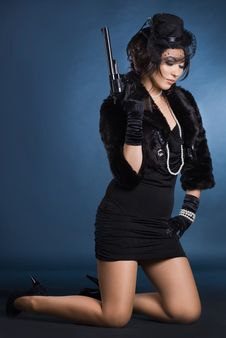 Free Elegant Lady With A Pistol Stock Photos - 16785743