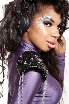Free Mulatto Girl DJ Listens Music Royalty Free Stock Photo - 16786105