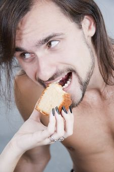 Free Young Man Eats A Cake From Female Hands Royalty Free Stock Photos - 16788268