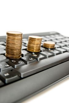 Free Coins On Keyboard Stock Photography - 16788602