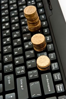 Free Coins On Keyboard Stock Images - 16788604