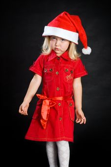 Free Displeased Girl In Red Dress And Santa Cap Royalty Free Stock Photo - 16790185