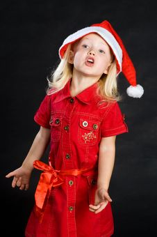 Free Shouting Girl In Red Dress And Santa Hat Stock Photos - 16790223