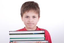 Free The Boy Holds A Pile Of Books Stock Images - 16795144