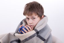 Free The Boy Covered By A Checkered Plaid, Drinks Royalty Free Stock Images - 16795349
