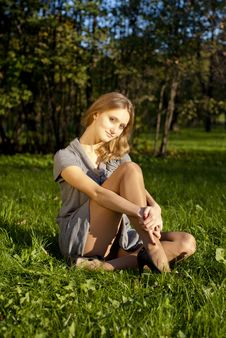 Young Girl On The Grass Stock Image
