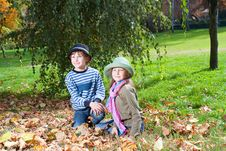 Free Happy Girl And Boy  Enjoying Golden Autumn Stock Photography - 16795792